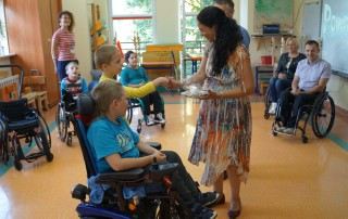 Dr. Veronica Schiariti receives a gift from children at the Step by Step Association for Help of Disabled Children in Zamosc, Poland